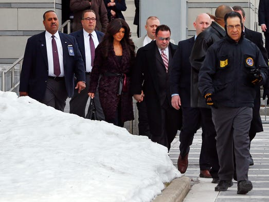 Teresa, center left, and Joe Giudice, center right, from 'The Real Housewives of New Jersey,' leave federal court in Newark, N.J. on Tuesday. They pleaded guilty to several counts including bankruptcy fraud.