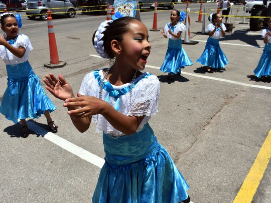 Dancers with Danzantes de Corazón entertain fiesta attendees on Saturday.