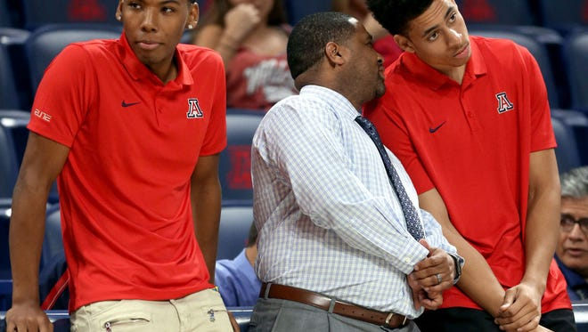 Allonzo Trier and Chance Comanche watch from the sidelines before Arizona's game against College of Idaho.