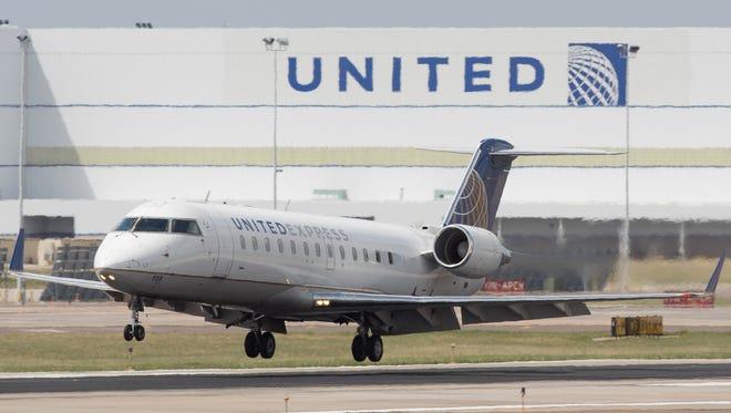 A United Express CRJ regional lands at Denver International Airport on May 7, 2017.