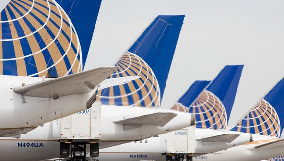 This file photo shows United Airlines planes lined up at Denver International Airport on May 7, 2017.