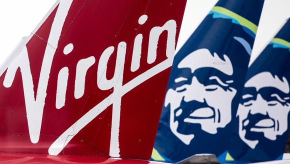 Virgin America and Alaska Airlines tails are seen at