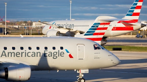 this file photo from 2016 shows American Airlines jets
