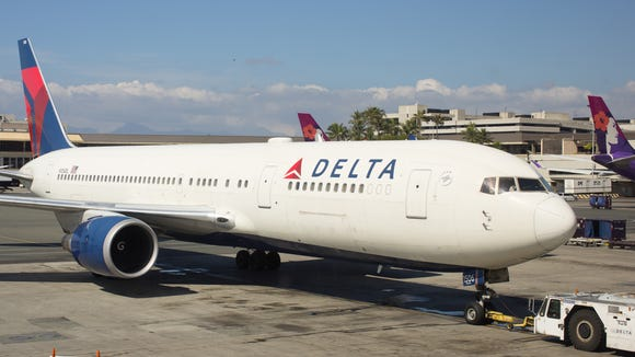 A Delta Air Lines Boeing 767-300 pushes back for departure