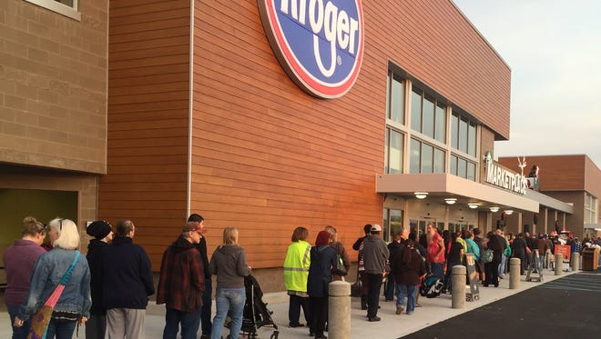 Long lines of customers wait to enter the new Kroger Marketplace at its grand opening on Nov. 2.