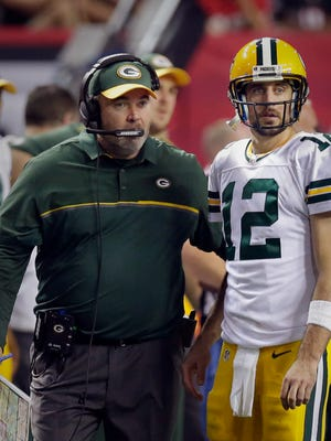 Packers coach Mike McCarthy and quarterback Aaron Rodgers have had their ups and downs this season.
