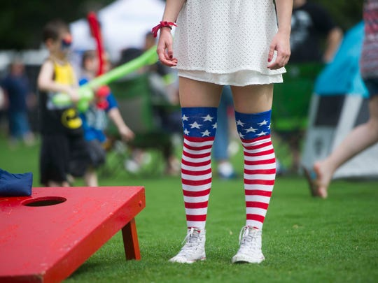 Rebekah Tate, 16, of Knoxville plays corn hole during the Festival on the Fourth celebration in World's Fair Park on Tuesday, July 4, 2017.