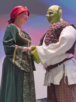 """Fionna,"" played by Miya Mattucci, and ""Shrek,"" portrayed by Dominic Ignagni, share a romantic scene in the Hartland Encore Youth Theater performance of ""Shrek the Musical Jr."""
