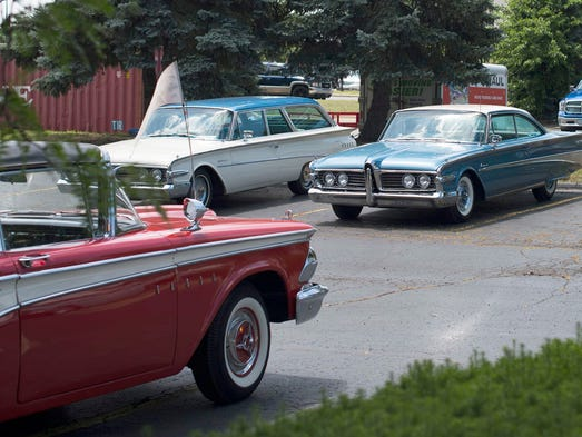 A prototype for the 1960 Ford Edsel Corsair, center,