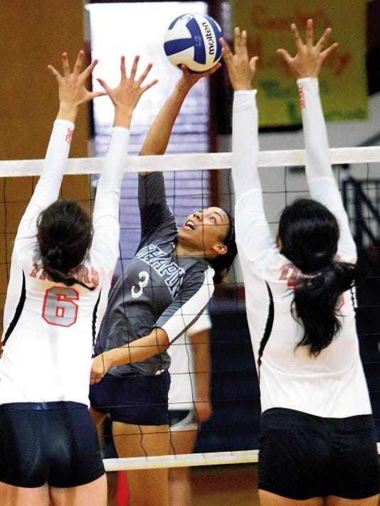 Rudy Gutierrez—El Paso Times Chapin senior Taylor Sterling, 3, fires a shot past El Paso High defenders Diana Lopez, left, and Paola Maese during the championship match of the YISD volleyball tournament Saturday at Riverside High School.