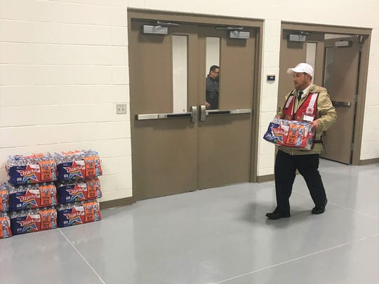 Salvation Army Capt. Patrick Gesner helps move cases of water that were later distributed to Coastal Bend residents whose homes were damaged by Hurricane Harvey. The storm made landfall in the Coastal Bend on Aug. 25 as a Category 4 hurricane with winds of over 130 mph.