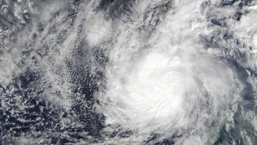 Philippines searches for 18 crewmen of ship sunk by typhoon