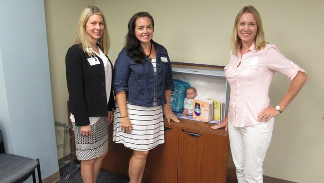 From left, Ginger King of IRMC, Andrea Berry of HSC and Emma White of the Chamber of Commerce with a Baby Box, a global initiative to equip parents with the vital education and resources needed to give babies a safe, healthy and equitable start in life.