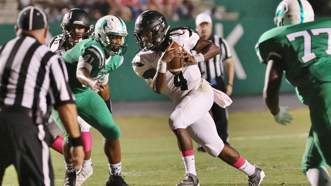 Forestview's Jamarion Dawkins finds running room in the Ashbrook defense in their game last fall.