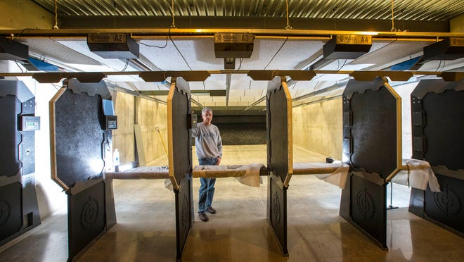 Managing partner Tom Hudson gives a tour of CrossRoads Shooting Sports, the first public Des Moines-area indoor shooting range, earlier this month in Johnston.