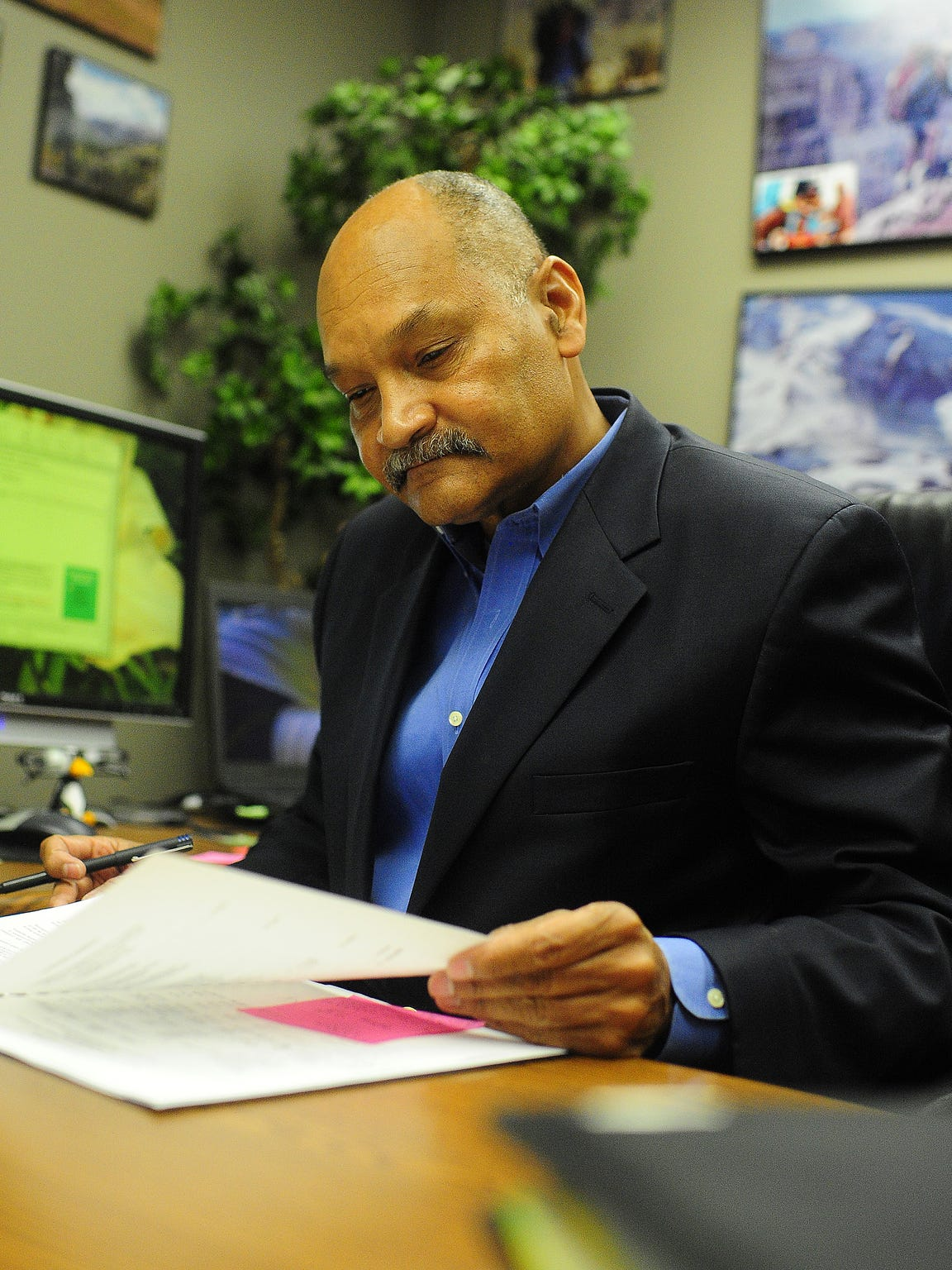 Greg Davis, director of the Cajundome, works in his office at the Cajundome.