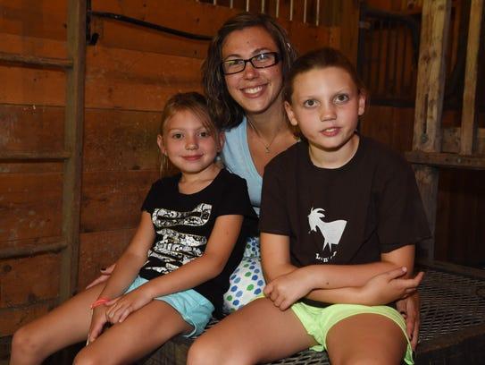 Madison Ranalli, 9, right, and Gianna Ranalli, 6, sit
