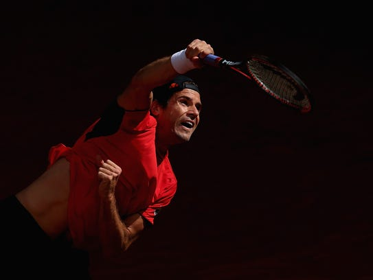 Tommy Haas of Germany serves to Igor Sijsling of Holland