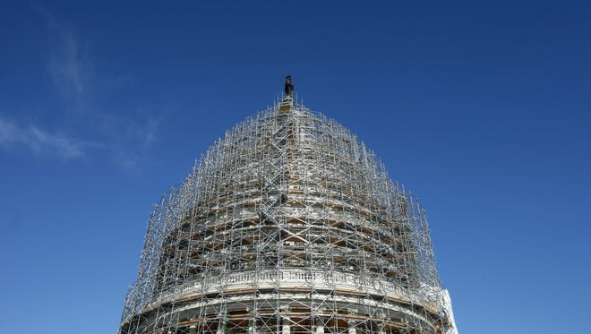 Scaffolding surrounds the U.S. Capitol Dome during the ongoing restoration project on Nov. 18, 2014.
