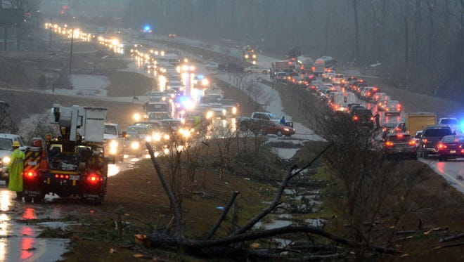 Traffic is blocked on US 98 East near Columbia, Miss., after a tornado touched down Tuesday.