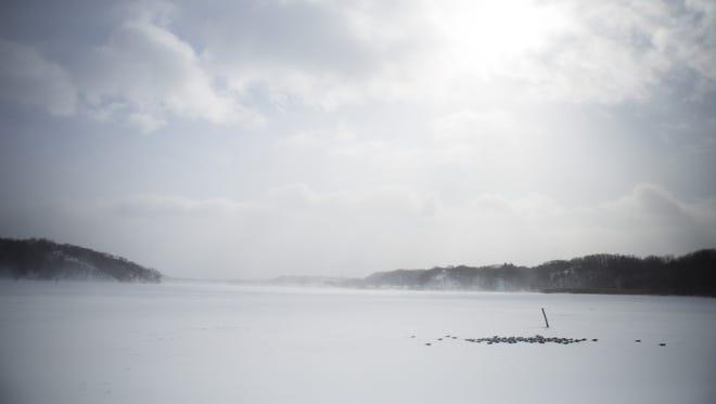 Snow blows across Irondequoit Bay.