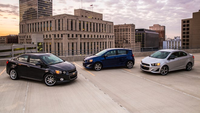 General Motors is closing for two plants for a week as demand for their cars falls and demand for big trucks jumps. Shown are 2015 Chevrolet Sonic models built at the Orion, Mich., factory set to close March 9 - 13. The other plant is at Oshawa, Ontario and will be down April 13 - 17.