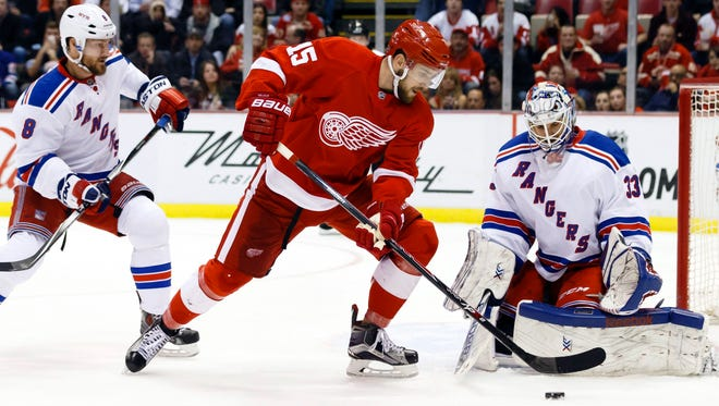Detroit Red Wings center Riley Sheahan tries to score on New York Rangers goalie Cam Talbot (33) in the third period at Joe Louis Arena on Wednesday. Detroit won 2-1 in overtime.