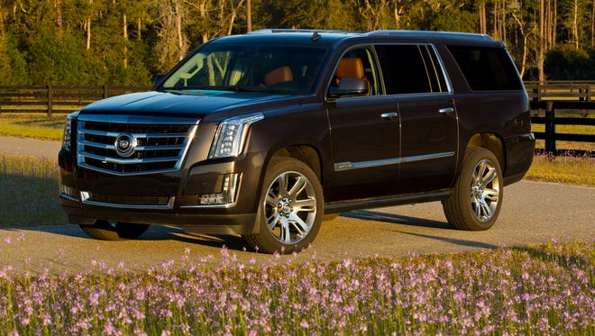 Owners of gas-electric hybrids and electric vehicles more and more  are forsaking their alt-power cars in favor of SUVs, such as this 2015 Cadillac Escalade ESV, according to data on 2015 purchases analyzed by Edmunds.com.