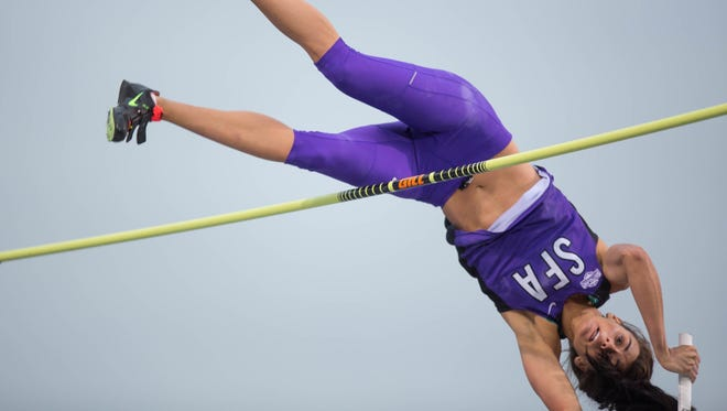 Demi Payne competes during Friday's pole vault competition.
