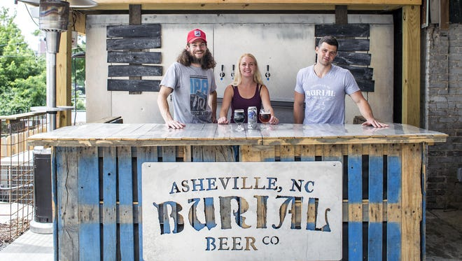 Burial Beer of Asheville donates brew to nonprofits when it can, but with limited production, it's tough to meet all requests. Pictured are brewer Tim Gormley, left, with owners Jess and Doug Reiser.