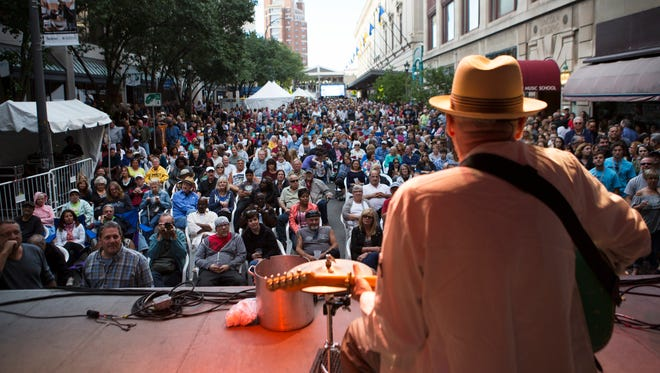 A large crowd enjoys music by Sauce Boss on the Jazz Street Stage during the first night of the Xerox Rochester International Jazz Festival on June 19, 2015.