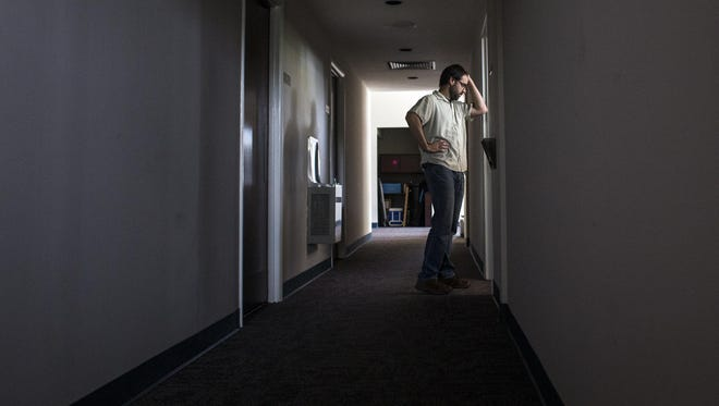 Matthew Raker, vice president of entrepreneurship at AdvantageWest, looks into his nearly empty office during one the last days of AdvantageWest's operation in Fletcher. The regional economic development nonprofit has been in its offices at the airport for its entire 21-year run.