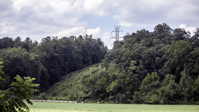 Already built and used Duke Energy power lines hang over pasture and mountains in Mills River feeding power to Asheville. Duke Energy is proposing running new power lines up from South Carolina through the Mills River area to provide even more energy to the growing area.