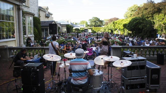Samantha Fish and her band perform as part of the Garden Vibes summer concert series at the George Eastman House.