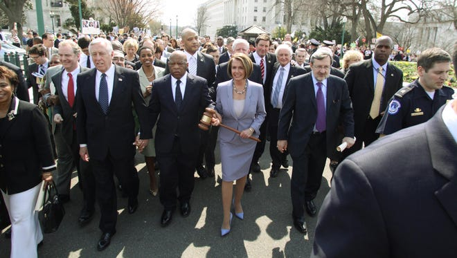 Congressional leaders including House Speaker Nancy Pelosi, D-Calif., and Rep. Dave Obey, D-Wausau, cross Independence Avenue to the U.S. Capitol before the vote on health care reform legislation on March 21, 2010.