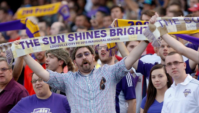 Louisville City fans cheer against Orlando City.  