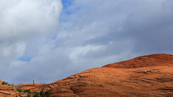 A hiker makes his way along the Petrified Dunes Trail in Snow Canyon State Park.