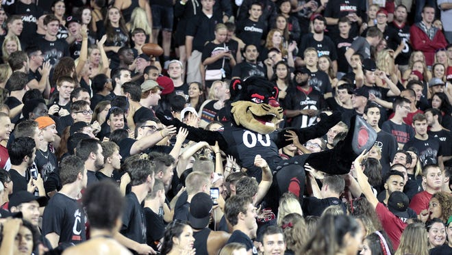 The UC Bearcat crowd surfs up the student section of the stands of during the Bearcats' home opener against Alabama A&M.