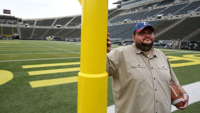 Statesman Journal reporter Pete Martini pauses for a photo at Autzen Stadium on Friday, July 10, 2015, in Eugene.