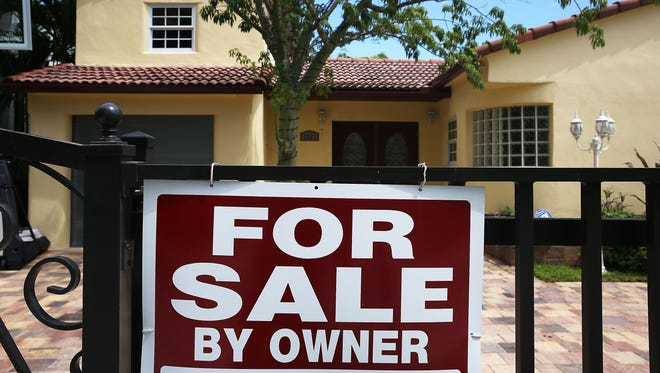 "A ""for sale"" sign is seen in Miami. Home ownership is no longer the issue on the campaign trail it once was."