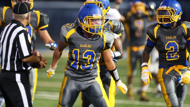 Daniel Harris, left,   Ty'Sean Sizer and their Irondequoit Eagles teammates had more reasons to celebrate in the second half of the 2015 regular season after a slow start.