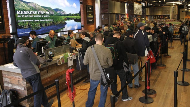 Customers wait in line at the REI in Manhattan's SoHo neighborhood. This year REI will close its stores on Black Friday and is encouraging employees and customers to spend time outside instead.