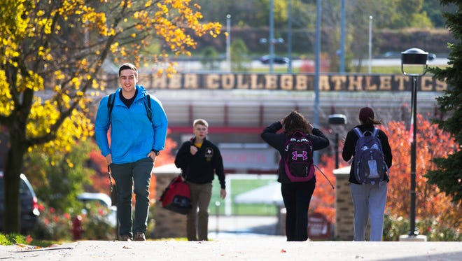 Chris Copeland walks to his personal finance class at St. John Fisher College on Thursday, Oct. 29. Copeland hopes to open a coffee shop near the canal targeting bicyclists in the future.