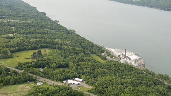 The U.S. Salt mine complex, right, sits on the shore of Seneca Lake, in the town of Reading, looking north up the length of Seneca Lake. Crestwood is proposing to store liquid propane gas in caverns created from the salt mining. The caverns are below the hillside west and north of the salt mine.
