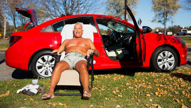 """Tony Stever of Scottsville sunbathes in a lawn chair and enjoys the record-setting temperature of 78 degrees in Cobbs Hill Park on Wednesday. Steve said he comes to the park nearly everyday to keep his tan when it's not warm enough to go to the beach. """"It's enjoyable, relaxing. I've been doing it all my life,"""" he said."""