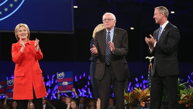 Democratic presidential candidates Hillary Clinton, Senator Bernie Sanders (I-VT), and Martin O'Malley are introduced at the Jefferson-Jackson dinner on Oct. 24 in Des Moines, Iowa.