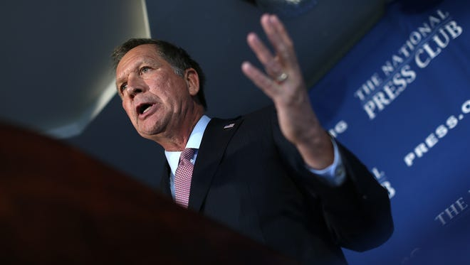 Ohio Gov. John Kasich answers questions after delivering remarks at the National Press Club on Nov. 17, 2015, in Washington.