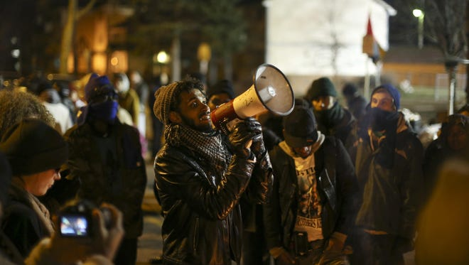 A demonstrator speaks in Minneapolis on Tuesday, Nov. 24, 2015. As of Wednesday morning, three men were in custody after five people were shot late Monday night near the 4th Precinct police station in north Minneapolis as part of the Black Lives Matter protest.
