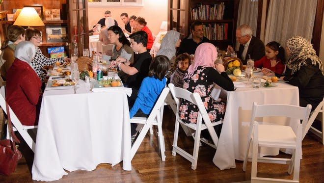 Syrian refugees and community leaders join together for a #RefugeesWelcome Thanksgiving dinner hosted by MoveOn.org on Nov. 20 in Evanston, Illinois.