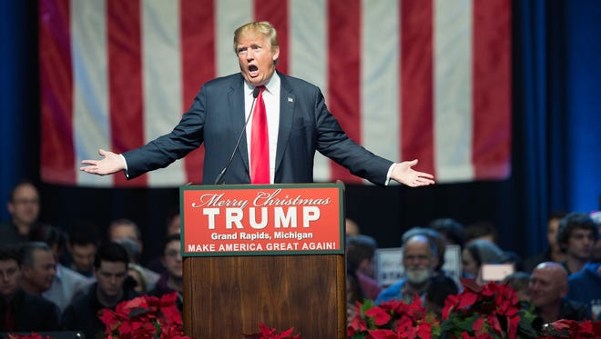Donald Trump speaks to guests at a campaign rally on Dec. 21, 2015, in Grand Rapids, Mich.